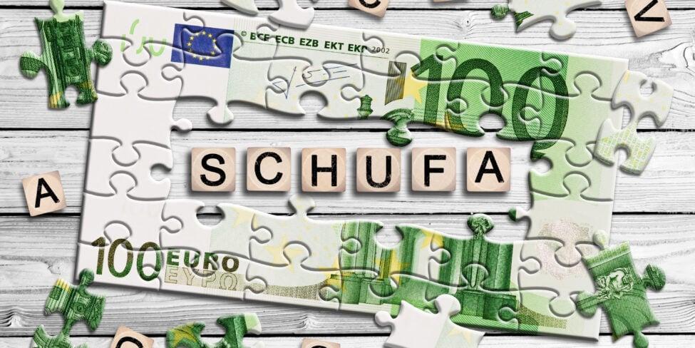 Schufa-Eintrag symbolisiert durch 100-Euro-Schein